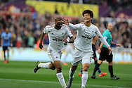 Andre Ayew of Swansea city celebrates with teammate Ki Sung-Yueng (r) after he scores his teams 1st goal. Barclays premier league match, Swansea city v Tottenham Hotspur at the Liberty Stadium in Swansea, South Wales on Sunday 4th October 2015.<br /> pic by  Andrew Orchard, Andrew Orchard sports photography.