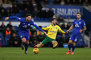 Sean Morrison of Cardiff city tackles Nelson Oliveira of Norwich city (c). EFL Skybet championship match, Cardiff city v Norwich city at the Cardiff city stadium in Cardiff, South Wales on Friday 1st December 2017.<br /> pic by Andrew Orchard, Andrew Orchard sports photography.