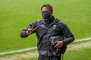 AFC Wimbledon defender Darnell Johnson (27) arriving for the game wearing face mask during the EFL Sky Bet League 1 match between AFC Wimbledon and Milton Keynes Dons at Plough Lane, London, United Kingdom on 30 January 2021.