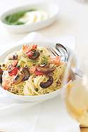 Salmon pasta with tomatoes, capers, and mushrooms.