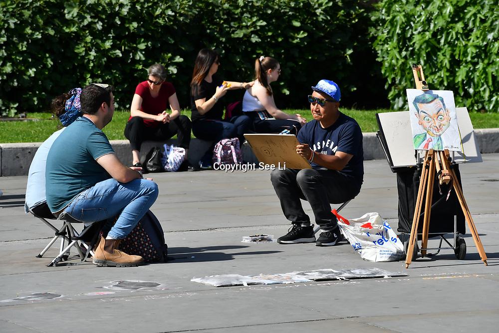 UK Weather - The Hottest week in June 2019, cartoon artist at Trafalgar Square, on 27 June 2019, London, UK
