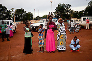 Women watch a British evangelical preacher who travels South Sudan in a trailor truck preaching to the largly christian region on May 26, 2010.