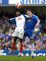 Photo: Daniel Hambury.<br />Chelsea v Portsmouth. The Barclays Premiership. 21/10/2006.<br />Chelsea's John Terry and Portsmouth's goal scorer Benjani Mwaruwari challange for the ball.
