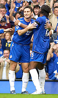 Photo: Daniel Hambury.<br />Chelsea v Blackburn Rovers. The Barclays Premiership.<br />29/10/2005.<br />Chelsea's Frank Lampard celebrates with Didier Drogba after making the score 2-0.