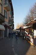 Gravirate. Lombardia. ITALY. General Views, up the hill towards, one of many entrances to the street,  Friday Market.  Italy<br />  <br /> Friday  30/12/2016<br /> <br /> © Peter SPURRIER,<br /> <br /> <br /> LEICA CAMERA AG - LEICA Q (Typ 116) - 1/500 - f4