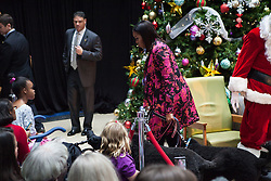 December 12, 2016 - Washington, DC, United States - On Monday, December 12, First Lady Michelle Obama, accompanied by First Dogs Bo, and Sunny, and TV and radio host Ryan Seacrest, greeted patients of Children's National Health System. (Credit Image: © Cheriss May/NurPhoto via ZUMA Press)