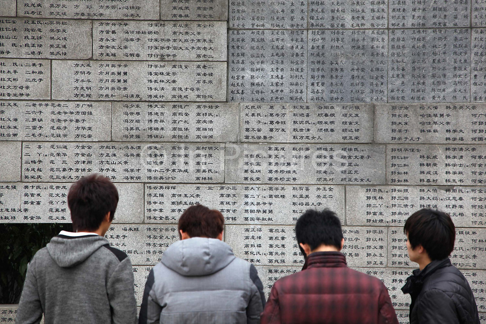 Visitors look at the names of the dead at  the Nanjing Massacre Memorial in Nanjing, China on 04 March, 2011.  After seizing Shanghai in late 1937, the Japanese Army went on a six-week rampage in Nanjing, then known as Nanking, slaughtering and raping waves of civilians in an episode that later became known as the Nanking Massacre or the Rape of Nanking. Most historians generally agree that at least 150,000 people were killed in the massacre — China puts the death toll at 300,000 — and tens of thousands raped.