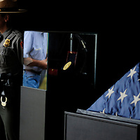 A member of the National Park Service stands by Congressional Gold Medal and the America Flag the flew on the U.S. Capital Building on the day of the terrorist attack 13 years ago, at the Flight 93 National Memorial on September 11, 2014.  UPI/Archie Carpenter