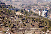 The recently completed train line between Jerusalem and Tel Aviv. a bridge spans a valley