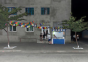 """NORTH KOREA:<br /> The pictures Kim Jong Un doesn't want you to see<br /> <br /> Since 2008, Eric Lafforgue ventured to North Korea six times. Thanks to digital memory cards, I was able to save photos that I was forbidden to take or was told to delete by the minders.<br /> <br /> Photo Shows:  One night, on the way back to the hotel my bus had to take an alternate route due to street closures. As we passed by old buildings, the guides asked me not to shoot with flash. The official reason was """"to avoid scaring people"""".<br /> ©Eric Lafforgue/Exclusivepix Media"""