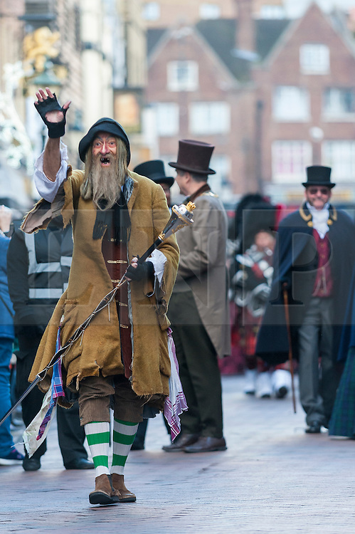 © Licensed to London News Pictures. 03/12/2016. Rochester, UK. A man dresses as Fagin from Oliver Twist as participants take part in the Rochester Dickensian Christmas Festival.  The Kent town is given a Victorian makeover to celebrate the life of the writer Charles Dickens (who spent much of his life there), with Victorian themed street entertainment, costumed parades and a Christmas market. Photo credit : Stephen Chung/LNP