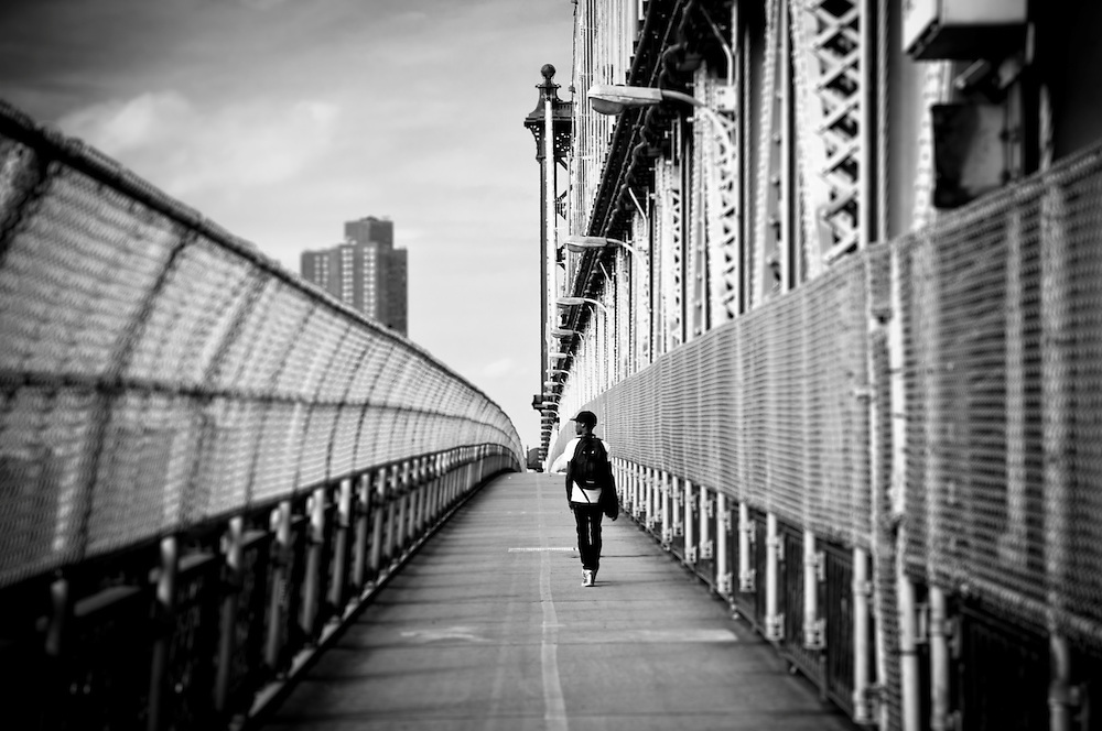 A young boy walks on the Manhattan bridge, New York, 2010.