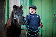 Sean Considine ,Ennistymon with his pony at Ennistymon Horse Fair ,Co Clare.