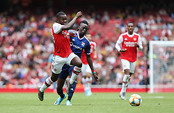 Edward Nketiah of Arsenal and Bertrand Traore of Lyon tussle for the ball - Mandatory by-line: Arron Gent/JMP - 28/07/2019 - FOOTBALL - Emirates Stadium - London, England - Arsenal v Olympique Lyonnais - Emirates Cup