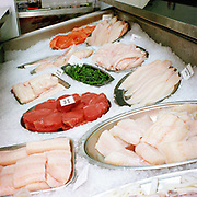 A selection of prepared fish on display at Fish in Crieff, Perthshire, Scotland. Owned by experienced fishmonger Willie Little, whose passion for the sea can be tasted at his Little's Restaurant in Blairgowie, these 'piscatorial surgeons' offer a wide range of fresh fish and shellfish bought direct from Scrabster Market in the North of Scotland - from market to plate within 12 hours.