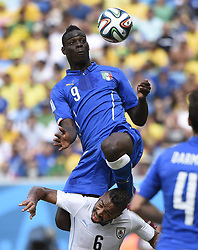 June 24, 2014 Natal, Brazil. Italy's Mario Balotelli (up) jumps for the ball during a Group D match 2014 FIFA World Cup match against Uruguay at the Estadio das Dunas Stadium in Natal, Brazil. Uruguay defeated Italy 1:0. (Credit Image: © Xinhua via ZUMA Wire)