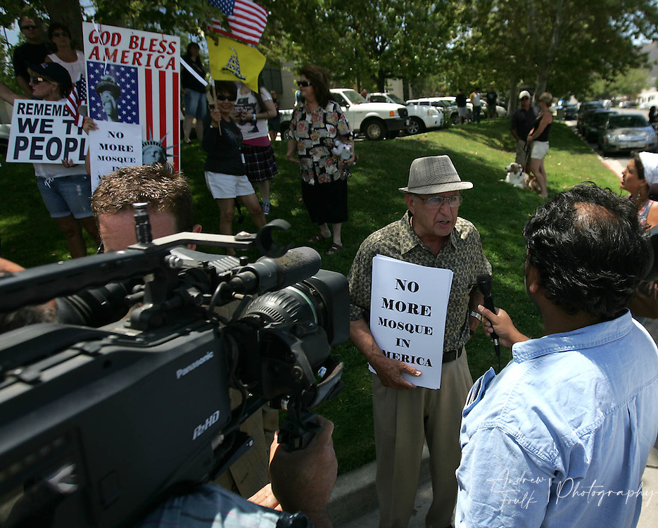 /Andrew Foulk/ For The Californian/ .Mano Bakh, of Wildomar, speaks to Television reporters about his concerns regarding the Temecula Islamic Center building of a new mosque in Temecula, during a protest staged outside the center Friday afternoon.