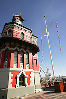 Cape Town, South Africa Clocktower historical building and landmark painted Red at the V&A Waterfront in Summer