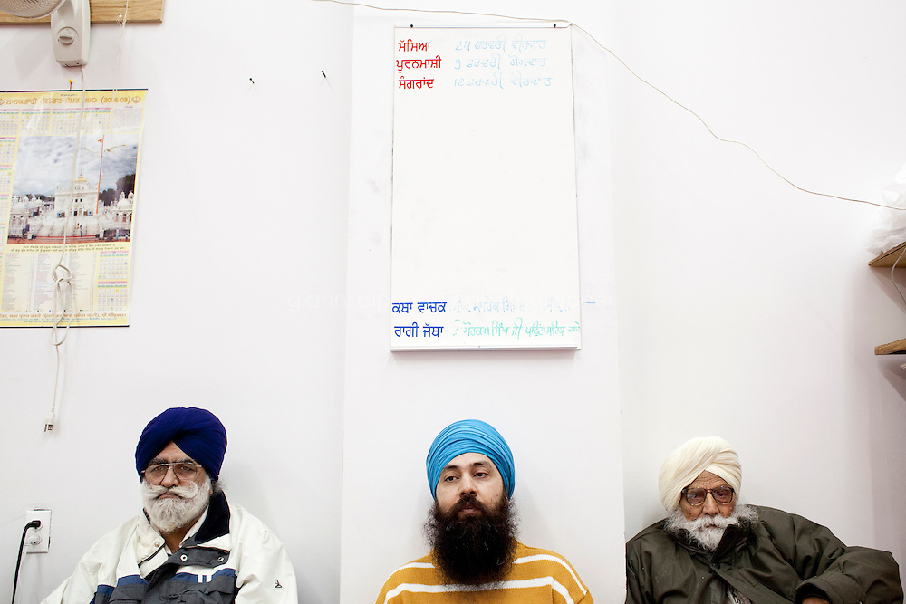 13 February, 2009.Bellerose, Queens, NY.  Three Sikhs listen to preacher Jaswinder Singh at the Gurdwara Sant Sagar Temple. The temple is still in construction and is planned to be completed by mid-April. The temple has been built next to the Veterans of Foreign Wars Hall in Bellerose, Queens, where demographics have changed in recent year.<br /> <br /> ©2009 Gianni Cipriano for The New York Times<br /> cell. +1 646 465 2168 (USA)<br /> cell. +1 328 567 7923 (Italy)<br /> gianni@giannicipriano.com<br /> www.giannicipriano.com