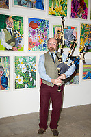 Professor Callum atthe Tate Liverpool exhibition of Liverpool NHS worker portraits by Aliza Nisenbaum  the exhibition celebrates Merseyside NHS workers=