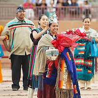 Zunneh-bah Martin passes the crown to Ashley Reine Claw the 2018-2019 Miss Gallup Inter-Tribal Ceremonial Queen at Red Rock Park, Friday August 10, 2018.