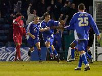 Photo: Alan Crowhurst.<br />Gillingham v Swindon Town. Coca Cola League 1. 14/01/2006. <br />Michael Flynn (C) celebrates his goal for Gillingham.
