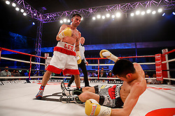 Lee Haskins (white shorts, red trim) beats Ryosuke Iwasa (black and printed shorts) by 6th Round stoppage to win the Interim IBF World Bantamweight Title Fight in his home City of Bristol - Photo mandatory by-line: Rogan Thomson/JMP - 07966 386802 - 13/06/2015 - SPORT - BOXING - Bristol, England - Action Indoor Sports Arena - Lee Haskins vs Ryosuke Iwasa - Interim IBF World Bantamweight Title Fight.