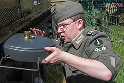 Reenactor portraying a member of 1 Kompanie Großdeutschland places a teller mine on one of the display tanks at Fort Paull<br /> <br />   04May 2015<br />   Image © Paul David Drabble <br />   www.pauldaviddrabble.co.uk