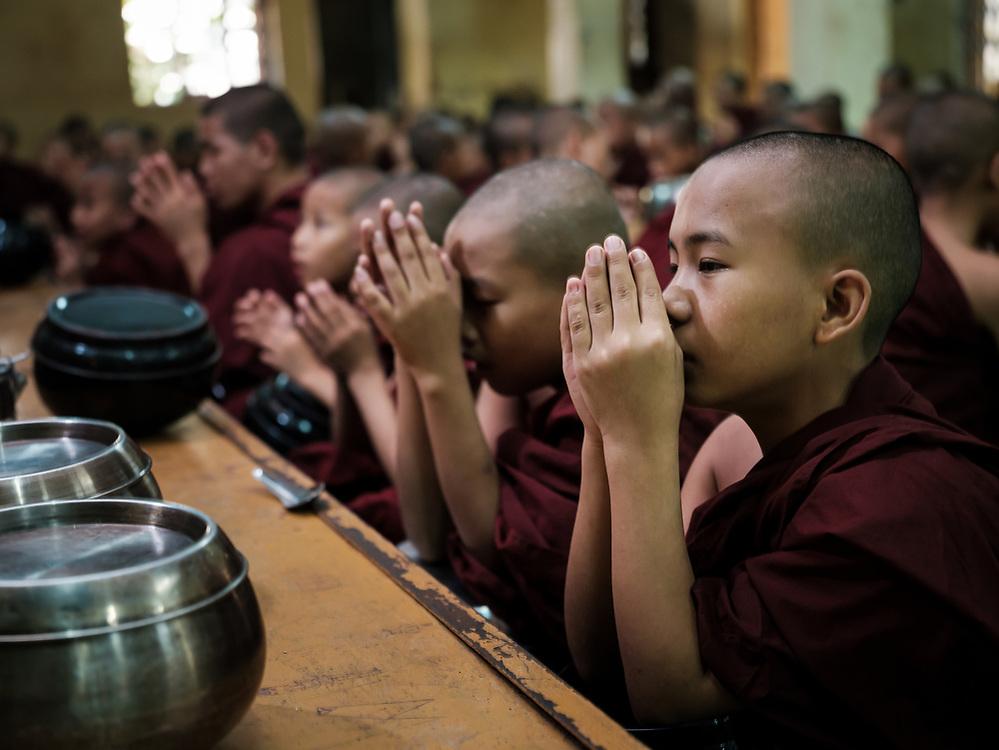 YANGON, MYANMAR - CIRCA DECEMBER 2017: Monks on a temple close to in Yangon.