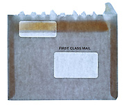 front view of an opened large first class mail business envelope