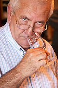 Jean-Pierre CLAUZEL, the owner, tasting his wine - Chateau La Grave Figeac, Saint Emilion, Bordeaux