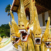 Serpentine naga at Haw Pha Bang (or Palace Chapel) at the Royal Palace Museum in Luang Prabang, Laos. The chapel sits at the northeastern corner of the grounds. Construction started in 1963.