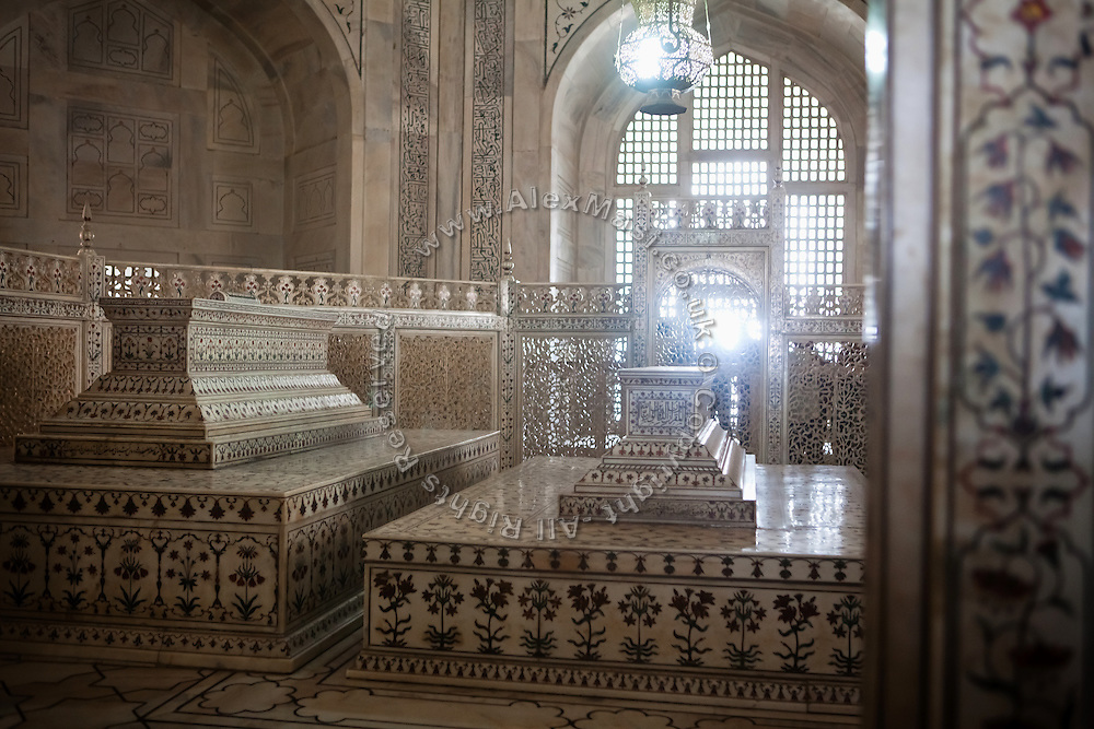 The tomb of  Mughal emperor Shah Jahan (left) is lying next to the one of his third wife, Mumtaz Mahal, (right) in the name of which the Taj Mahal mausoleum was also built and completed around the year 1653. in Agra .