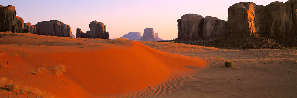 ARIZONA, MONUMENT VALLEY TRIBAL PARK Panorama of sandstone monuments seen with sanddunes in the foreground