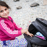 Rayyan 7 years old from Iraq with her luggage in Kara Tepe camp in Lesvos, Greece