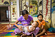 20 MAY 2013 - MAE KASA, TAK, THAILAND: A woman with her children in the SMRU clinic in Mae Kasa. Health professionals are seeing increasing evidence of malaria resistant to artemisinin coming out of the jungles of Southeast Asia. Artemisinin has been the first choice for battling malaria in Southeast Asia for 20 years. In recent years though,  health care workers in Cambodia and Myanmar (Burma) are seeing signs that the malaria parasite is becoming resistant to artemisinin. Scientists who study malaria are concerned that history could repeat itself because chloroquine, an effective malaria treatment until the 1990s, first lost its effectiveness in Cambodia and Burma before spreading to Africa, which led to a spike in deaths there. Doctors at the Shaklo Malaria Research Unit (SMRU), which studies malaria along the Thai Burma border, are worried that artemisinin resistance is growing at a rapid pace. Dr. Aung Pyae Phyo, a Burmese physician at a SMRU clinic just a few meters from the Burmese border, said that in 2009, 90 percent of patients were cured with artemisinin, but in 2010, it dropped to about 70 percent and is now between 55 and 60 percent. He said the concern is that as it becomes more difficult to clear the parasite from a patient, progress that has been made in combating malaria will be lost and the disease could make a comeback in Southeast Asia.    PHOTO BY JACK KURTZ