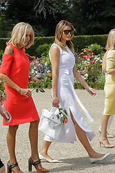 Brigitte Macron, wife of French President Emmanuel Macron, and U.S. First Lady Melania Trump walk in the garden of the Villa Arnaga, House-museum of Edmond Rostand, during a visit on traditional Basque culture in Combo-les-Bains, near Biarritz as part of the G7 summit, August 25, 2019. Photo by Thibaud Moritz/ABACAPRESS.COM