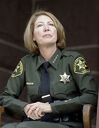 cutline_leadin>NEW CHALLENGES: Sheriff Sandra Hutchens was publicly sworn in as Orange County's first female top officer Tuesday, June 24, in a large public ceremony held under sunny skies with calls for an end of ''dark days.''..////ADDITIONAL INFO//// sheriff.0624.jah.shot 062408 Jebb Harris ,The Orange County Register. .Sheriff Sandra Hutchens was sworn in as the 12th Sheriff of the County of Orange on Tuesday, June .24th on the steps in front of the Old County Court House, in Santa Ana (Credit Image: Orange County Register/ZUMAPRESS.com)