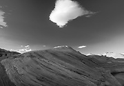 Cloud floating over sandstone. Lake Powell, Glen Canyon National Recreation Area, Utah, USA.