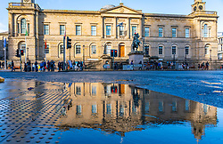 Reflection of General Register House the National Archives of Scotland on Princes Street in Edinburgh, Scotland, UK