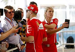 November 23, 2017 - Abu Dhabi, United Arab Emirates - Motorsports: FIA Formula One World Championship 2017, Grand Prix of Abu Dhabi, .#5 Sebastian Vettel (GER, Scuderia Ferrari),   Britta Roeske (GER) (Credit Image: © Hoch Zwei via ZUMA Wire)