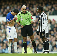 Photo: Aidan Ellis.<br /> Everton v Newcastle. The Barclays Premiership.<br /> 27/11/2005.<br /> referee Mr H Webb tells Everton's Tim Cahill and Newcastle's Celestine Babayaro to calm down after an off the ball incident