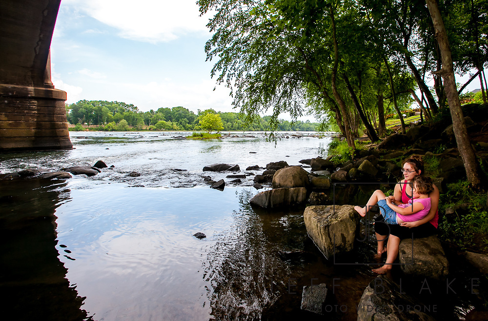 Ashley Baughman and her sister, Madison Baughman, 5, watch the rain fall on the Congaree River from under the Gervais Street Bridge. Photo by Columbia, SC, photojournalist Jeff Blake