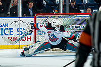 KELOWNA, BC - FEBRUARY 28: Roman Basran #30 of the Kelowna Rockets does the splits to make a save against the Everett Silvertips at Prospera Place on February 28, 2020 in Kelowna, Canada. (Photo by Marissa Baecker/Shoot the Breeze)