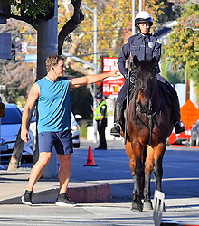 EXCLUSIVE: Chris Pratt is seen racing a horse as he films a scene for an unknown project in Los Angeles. Chris was seen racing through the streets and joking with a police officer on a horse as he filmed scenes. 14 Jan 2018 Pictured: Chris Pratt. Photo credit: Snorlax / MEGA TheMegaAgency.com +1 888 505 6342