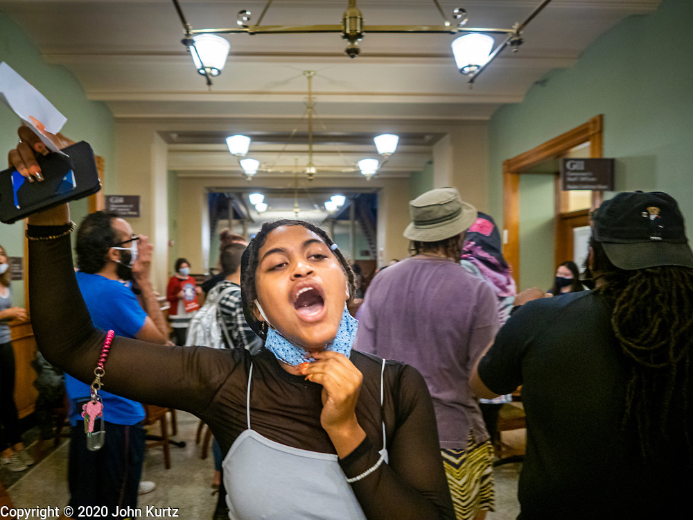 19 JUNE 2020 - DES MOINES, IOWA: Members of Black Lives Matter march in the hallway in front of the Governor's office during a Juneteenth rally in the Iowa State Capitol. About 100 supporters of Des Moines Black Lives Matter finished their week long series of protests at the Iowa State Capitol with a Juneteenth rally and demonstration. They are demanding that Gov. Kim Reynolds use an executive order to restore voting rights to felons who have completed their sentences. The protesters did not meet with the Governor Friday. The protest was peaceful.     PHOTO BY JACK KURTZ