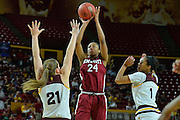 March 18, 2016; Tempe, Ariz;  New Mexico State Aggies forward Brianna Freeman (24) shoots over Arizona State Sun Devils forward Sophie Brunner (21) during a game between No. 2 Arizona State Sun Devils and No. 15 New Mexico State Aggies in the first round of the 2016 NCAA Division I Women's Basketball Championship in Tempe, Ariz. The Sun Devils defeated the Aggies 74-52.