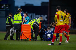 Dundee's Ross Callachan tackled by Partick Thistle's Stuart Bannigan, but is stretched off. Dundee 2 v 0 Partick Thistle, Scottish Championship game played 8/2/2020 at Dundee stadium Dens Park.
