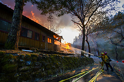 October 29, 2019, CA, USA: Firefighter battle a home on fire along Hyw.128  during the Kincade Fire in Sonoma County on Tuesday, October 29, 2019 in  (Credit Image: © Paul Kitagaki Jr./ZUMA Wire)