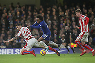 Geoff Cameron of Stoke City fouls Willianof Chelsea © in the box and a penalty is given..<br /> Premier league match, Chelsea v Stoke city at Stamford Bridge in London on Saturday 30th December 2017.<br /> pic by Kieran Clarke, Andrew Orchard sports photography.